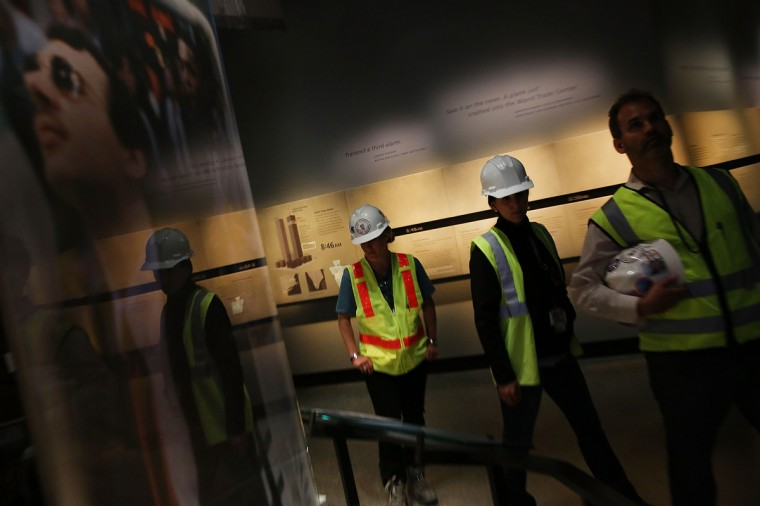 Port Authority workers tour the National September 11 Memorial Museum on May 14, 2014 in New York City. (Spencer Platt/Getty Images)