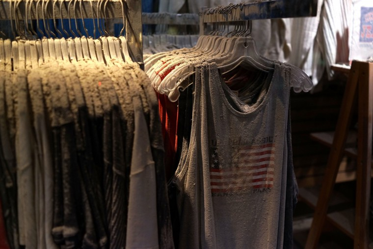Dust, ash and debris from the collapsed Twin Towers are viewed on the clothes from the store Chelsea Jeans in an exhibit at viewed during a preview of the National September 11 Memorial Museum. (Spencer Platt/Getty Images)