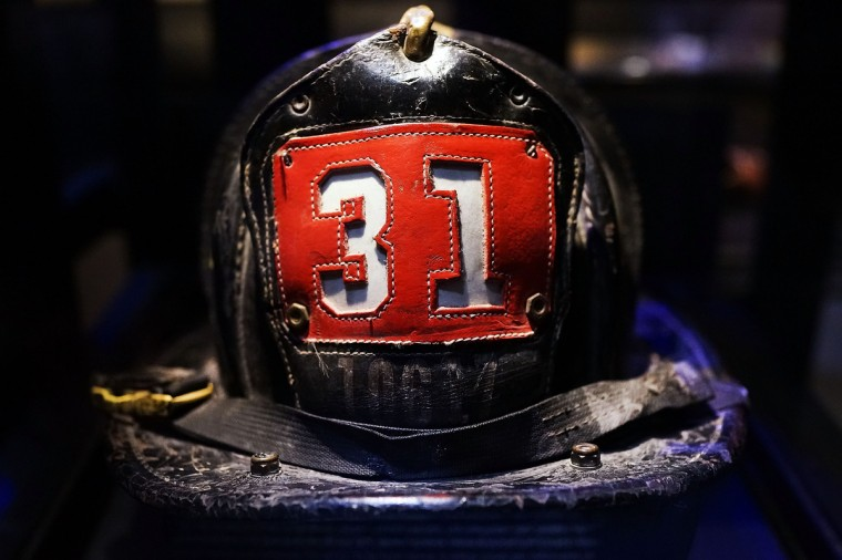 Surviving firefighter Dan Potter's fire helmet, which he used at Ground Zero on September 11, is viewed during a tour the National September 11 Memorial Museum. (Spencer Platt/Getty Images)