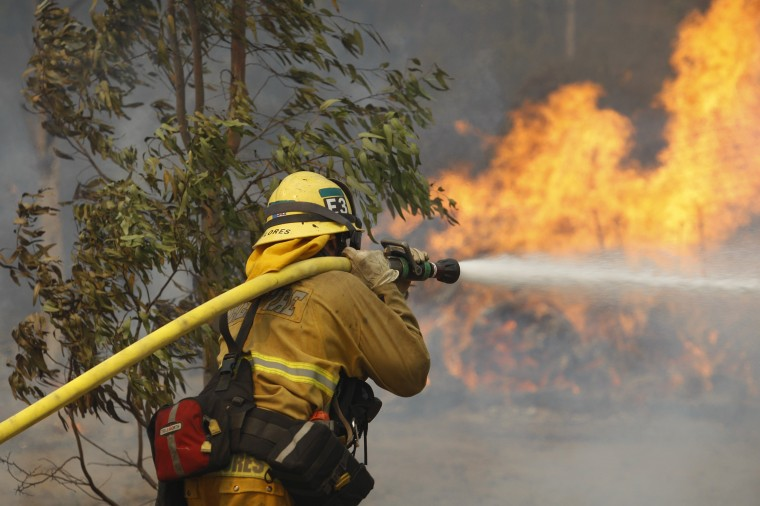 A firefighter hoses flames at the Cocos fire on May 15, 2014 in San Marcos, California. Fire agencies throughout the state are scrambling to prepare for what is expected to be a dangerous year of wildfires in this third year of extreme drought in California. (Photo by David McNew/Getty Images)