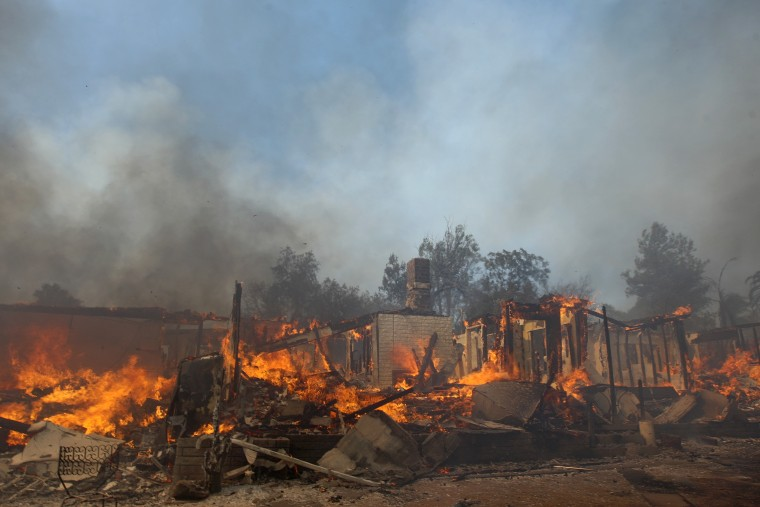 A house burns at the Cocos fire on May 15, 2014 in San Marcos, California. Fire agencies throughout the state are scrambling to prepare for what is expected to be a dangerous year of wildfires in this third year of extreme drought in California. (Photo by David McNew/Getty Images)