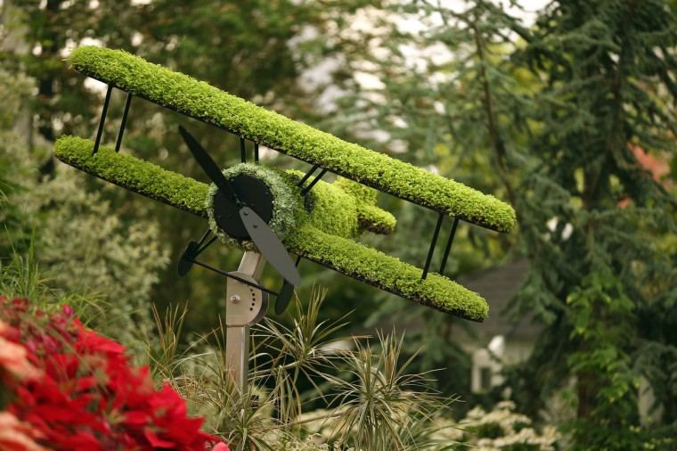 A floral bi-plane on display on the Birmingham City Council garden at the 2014 Chelsea Flower Show at Royal Hospital Chelsea on May 19, 2014 in London, England. The prestigious gardening show opens to the general public on May 20, 2014, and features hundreds of stands and exhibition gardens. (Dan Kitwood/Getty Images)