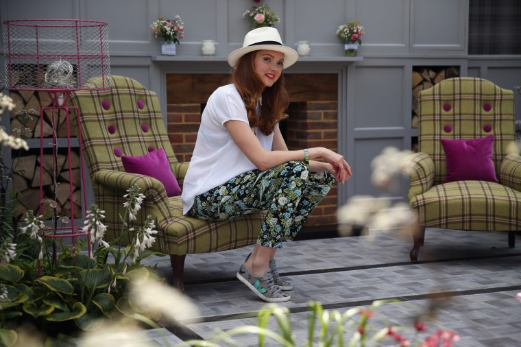 Lilly Cole poses during a photocall on the House of Fraiser stand at the 2014 Chelsea Flower Show at Royal Hospital Chelsea on May 19, 2014 in London, England. The prestigious gardening show opens to the general public on May 20, 2014, and features hundreds of stands and exhibition gardens. (Dan Kitwood/Getty Images)