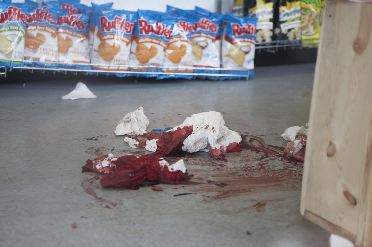 Blood on the floor of the IV Deli Mart, one of several crime scenes on May 24, 2014 in Isla Vista, California. A mentally disturbed 22-year-old man sprayed bullets from his car in the Southern California college town of Isla Vista, killing seven people. (Spencer Weiner/Getty Images)