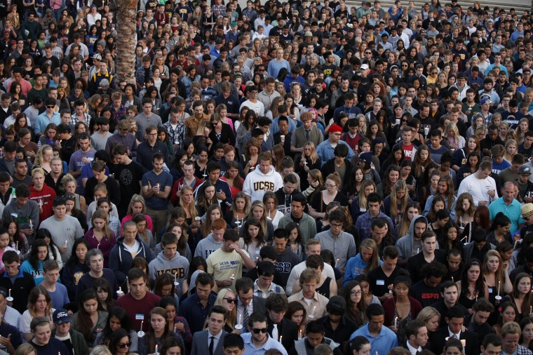 Students gather on the UC Santa Barbara campus for a candlelight vigil for those affected by the tragedy in Isla Vista on May 24, 2014 in Santa Barbara, California. A man was shot and killed at the store in Friday night's rampage, one of the several crime scenes. A mentally disturbed 22-year-old man sprayed bullets from his car in the Southern California college town of Isla Vista, killing six people. (Spencer Weiner/Getty Images)