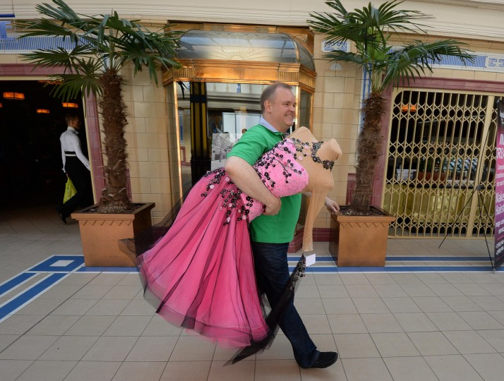 A man arrives with a mannequin for the British Open Dance Championships at the Winter Gardens in Blackpool, England. Couples from all over the world gather in Blackpool for the Latin professional British open championships which forms part of the Blackpool Dance Festival that began in 1920 at the Winter Gardens ballroom. The festival covers a 9 day period with professional and amateur couples competing in Ballroom and Latin competitions. (Nigel Roddis/Getty Images)