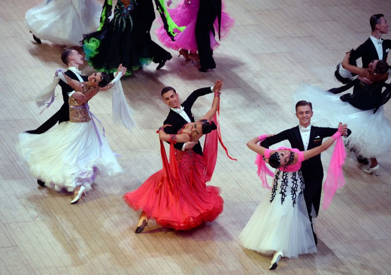 Competitors perform during the British Amateur Championships at the Winter Gardens in Blackpool, England. Couples from all over the world gather in Blackpool for the Latin professional British open championships which forms part of the Blackpool Dance Festival that began in 1920 at the Winter Gardens ballroom. The festival covers a 9 day period with professional and amateur couples competing in Ballroom and Latin competitions. (Nigel Roddis/Getty Images)
