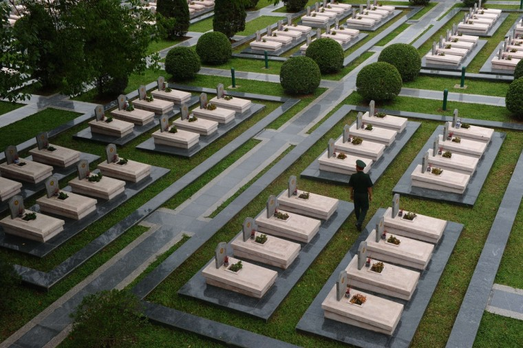 A soldier walks among graves of Vietnamese soldiers killed during the Dien Bien Phu battle at the official military cemetery in the northwestern town of Dien Bien Phu. Vietnam is getting ready to celebrate the 60th anniversary, on May 7, of its victory over France at the Dien Bien Phu battle in 1954. (Hoang Dinh Nam/Getty Images)
