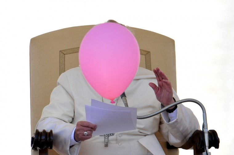 A balloon flies past Pope Francis during his general audience in St Peter's Square at the Vatican. (Tiziana Fabi/Getty Images)