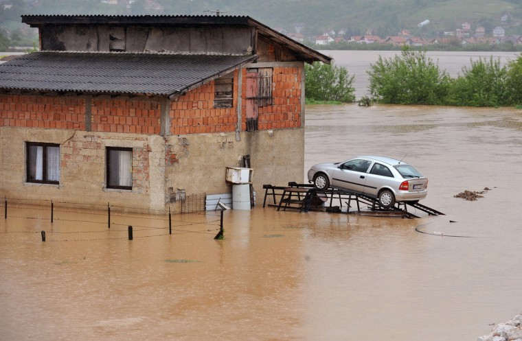 A Car-owner has parked his vehicle on ramps for protection in Sarajevo's Western suburb of Doglodi, as the river Bosna has flooded the surrounding area after heavy rainfall. (Elvis Barukcic/Getty Images)