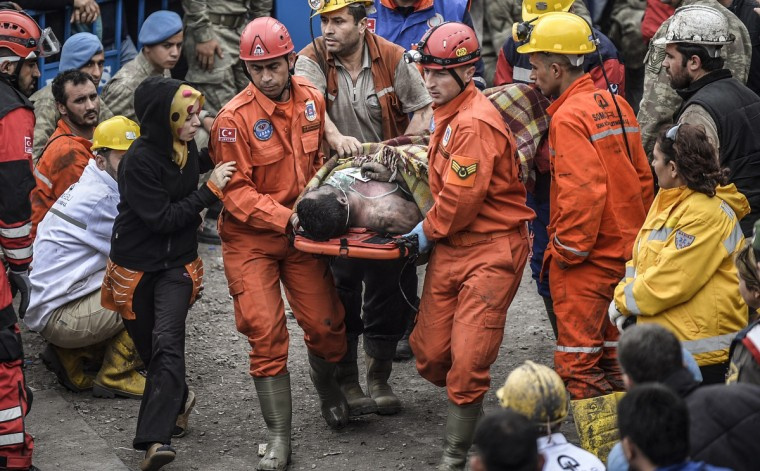 A woman reacts as she searches for relatives while rescuers carry out dead miners after an explosion and fire in a coal mine in the western Turkish province of Manisa killed at least 201 people and hundreds remain trapped underground. (Bulent Kilic/Getty Images)