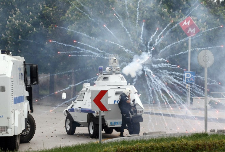 Proteters clash with Turkish police in Ankara during a demonstration gathering hundreds after more than 200 people were killed in an explosion at a mine. Police fired tear gas and water cannon when around 800 protesters shouting slogans against the government faced police intervention attempted to march from the Middle East Technical University to the energy ministry. (Adem Altan/Getty Images)