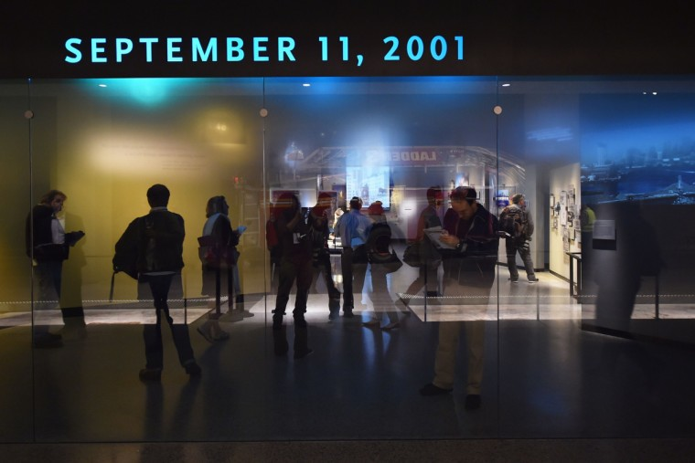Members of the media in the Historical Exhibition area during a press preview of the National September 11 Memorial Museum at the World Trade Center site May 14, 2014 in New York. (Stan Honda/Getty Images)