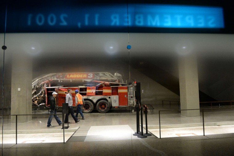 Remains of a New York City Fire Department Ladder Company 3 truck is seen during a press preview of the National September 11 Memorial Museum at the World Trade Center site May 14, 2014 in New York. (Stan Honda/Getty Images)