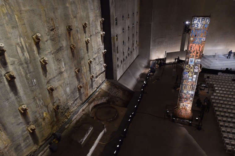 The symbolic Last Column (R), a steel beam from one of the World Trade Center towers, stands near the Slurry Wall (L), which holds back the Hudson River waters, seen during a press preview of the National September 11 Memorial Museum at the World Trade Center site May 14, 2014 in New York. (Stan Honda/Getty Images)