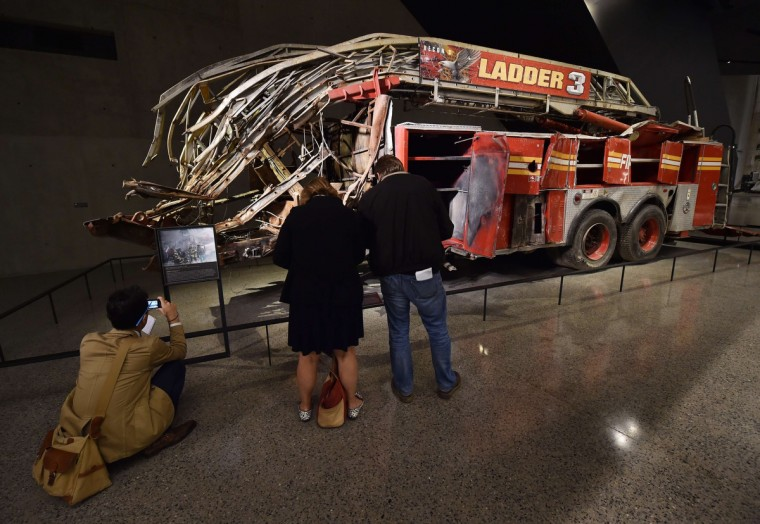 Remains of a New York City Fire Department Ladder Company 3 truck just outside the Historical Exhibition area during a press preview of the National September 11 Memorial Museum at the World Trade Center site May 14, 2014 in New York. (Stan Honda/Getty Images)