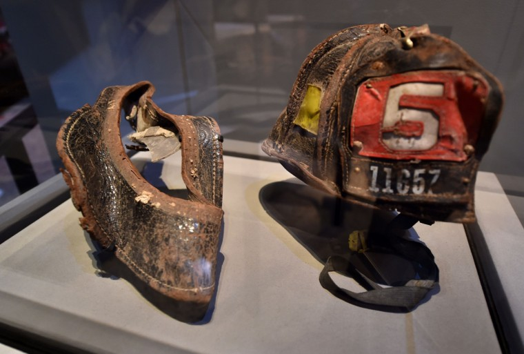 Helmets worn by New York City Fire Department Firefighter Christian Waugh on September 11, 2001,are seen during a press preview of the National September 11 Memorial Museum at the World Trade Center site May 14, 2014 in New York. (Stan Honda/Getty Images)