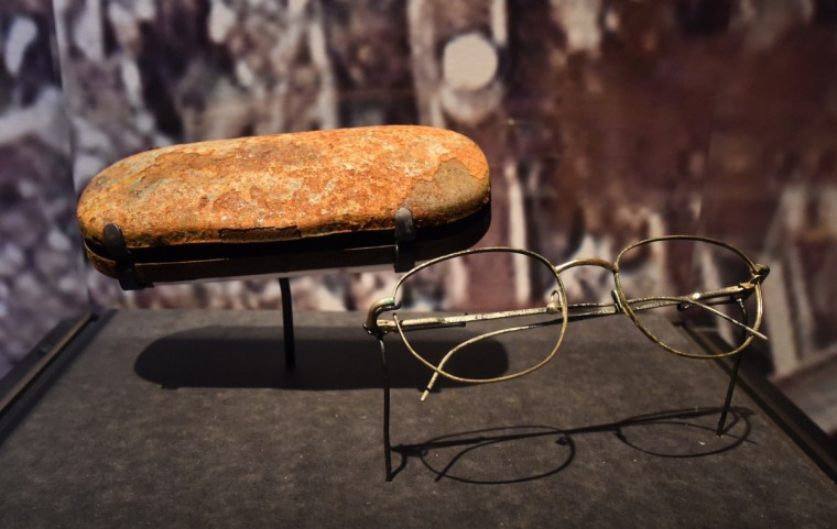Eyeglasses and a case found in the World Trade Center wreckage, seen during a press preview of the National September 11 Memorial Museum at the World Trade Center site May 14, 2014 in New York. (Stan Honda/Getty Images)