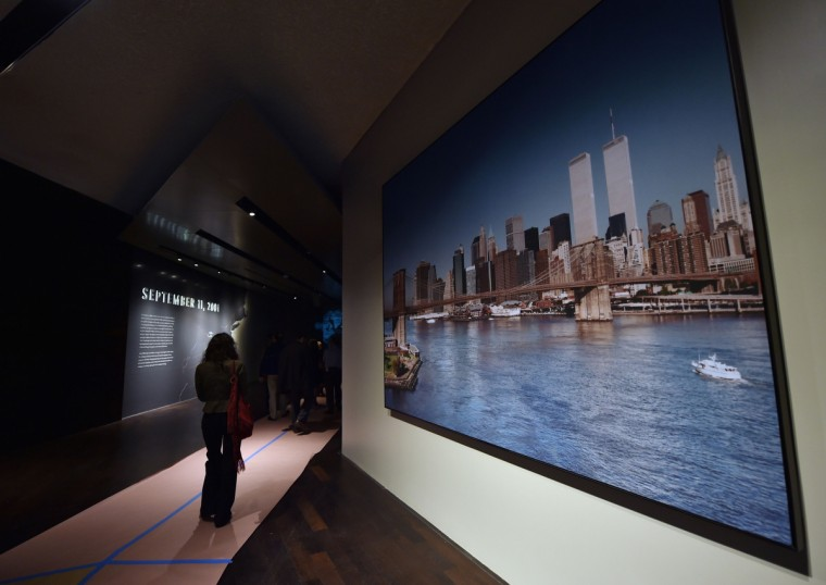 A photograph of the World Trade Center twin towers(R) are seen during a press preview of the National September 11 Memorial Museum at the World Trade Center site May 14, 2014 in New York. (Stan Honda/Getty Images)