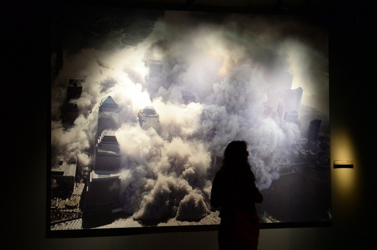 A photograph of one of the World Trade Center towers collapsing after the September 11, 2001 attack, seen during a press preview of the National September 11 Memorial Museum at the World Trade Center site May 14, 2014 in New York. (Stan Honda/Getty Images)