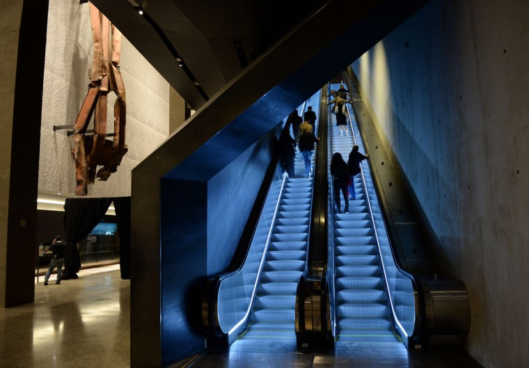 Escalators going up to street level past a section of steel facade from the North Tower, floors 96 to 99, (L) seen during a press preview in the National September 11 Memorial Museum at the World Trade Center site. (Stan Honda/Getty Images)