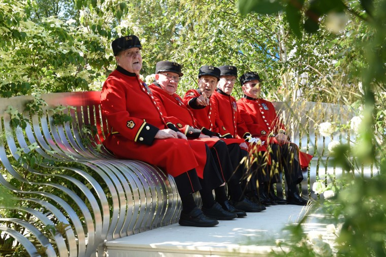 A group of Chelsea Pensioners pose for photographers on the London Square display at the Chelsea Flower Show in west London, on May 19, 2014. The Chelsea flower show, held annually in the grounds of the Royal Hospital Chelsea, will run this year from May 20-24. (Leon Neal/Getty Images)