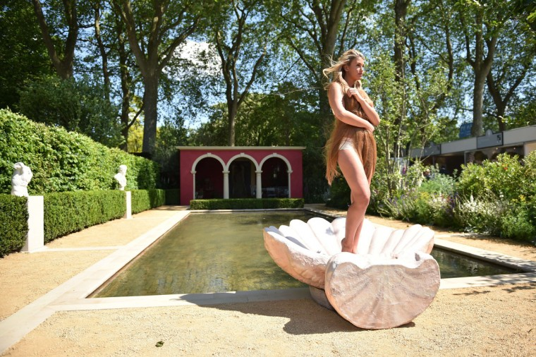 "British model Amy Willerton strikes a pose to imitate the painting ""Birth of Venus"" by Botticelli as she poses for photographers at the Chelsea Flower Show in west London, on May 19, 2014. The Chelsea flower show, held annually in the grounds of the Royal Hospital Chelsea, will run this year from May 20-24. (Leon Neal/Getty Images)"