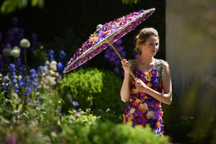 "British model Nina Schubert models this year's M&G dress, made with Orchida ""Vanda"" heads, at the Chelsea Flower Show in west London, on May 19, 2014. The Chelsea flower show, held annually in the grounds of the Royal Hospital Chelsea, will run this year from May 20-24. (Leon Neal/Getty Images)"