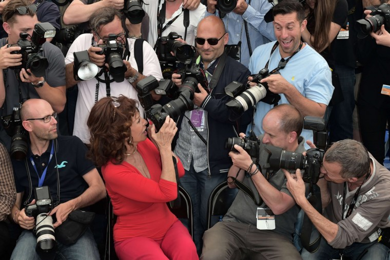 "Italian actress Sophia Loren holds a professional camera as she sits among photographers during a photocall for ""Voce Umana"" at the 67th edition of the Cannes Film Festival in Cannes, southern France. (Bertrand Langlois/Getty Images)"