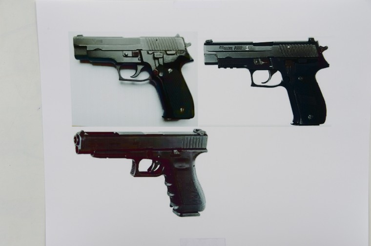 Photos of Glock 34 handguns, similar to the ones used by murder suspect Elliot Rodger are seen at a press conference by the Santa Barbara County Sheriff in Goleta, California May 24, 2014. Rodger, 22, went on a rampage in Isla Vista near the University of California at Santa Barbara campus, stabbed three people to death at his apartment before shooting to death three more in a terrorizing crime spree through the neighborhood.