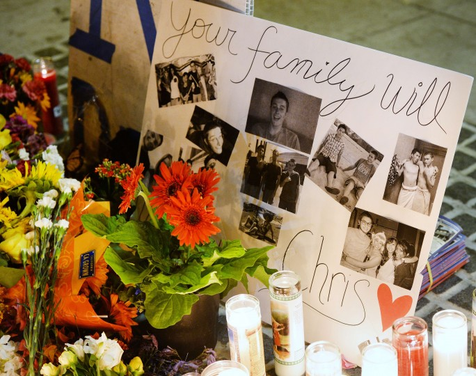 A memorial for shooting victim Christopher Michael-Martinez is seen outside the IV Deli Mart where he was shot and killed near the University of California, Santa Barbara campus during a candlelight vigil for those affected by the tragedy in Isla Vista on May 24, 2014 in Santa Barbara, California. (Robyn Beck/AFP/Getty Images)