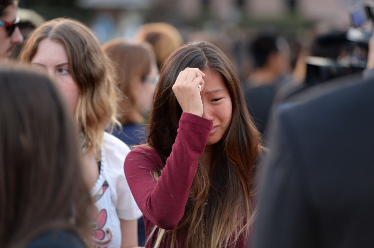 A student weeps during a candlelight vigil on May 24, 2014 for those affected by a killing spree in Isla Vista, on the University of California Santa Barbara campus in Santa Barbara, California. (Robyn Beck/AFP/Getty Images)
