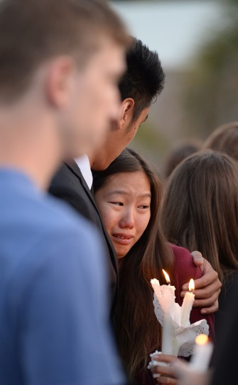 Students comfort each other during a candlelight vigil on May 24, 2014 for those affected by a killing spree in Isla Vista, on the University of California Santa Barbara campus in Santa Barbara, California. (Robyn Beck/AFP/Getty Images)