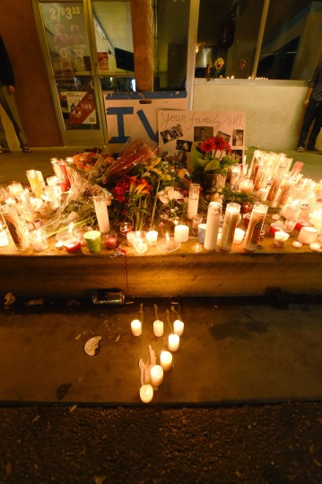 Students gather on May 24, 2014 at the University of Santa Barbara campus for a candlelight vigil for those affected by a killing spree in Isla Vista in Santa Barbara, California. (Robyn Beck/AFP/Getty Images)
