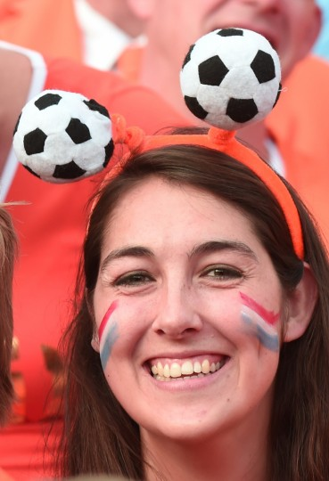 A Netherland's fan prepares to support her team before the international friendly football match Netherlands against Ghana at the Kuip Stadium in Rotterdam. (Damien Meyer/AFP/Getty Images)
