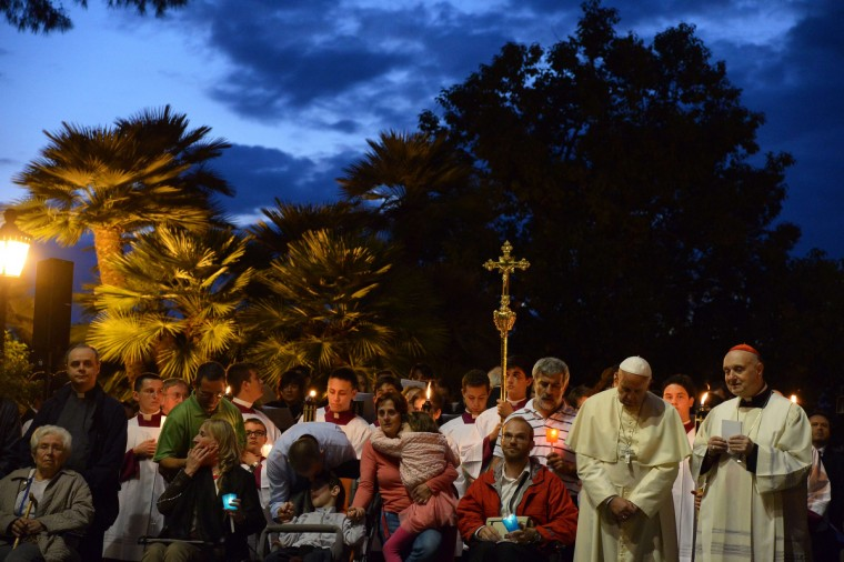 Pope Francis, center, prays at the Lourdes Grotto in the Vatican's Gardens during the celebration of a rosary event marking the closing of the Marian month on May 31, 2014. (Vincenzo Pinto/AFP/Getty Images)