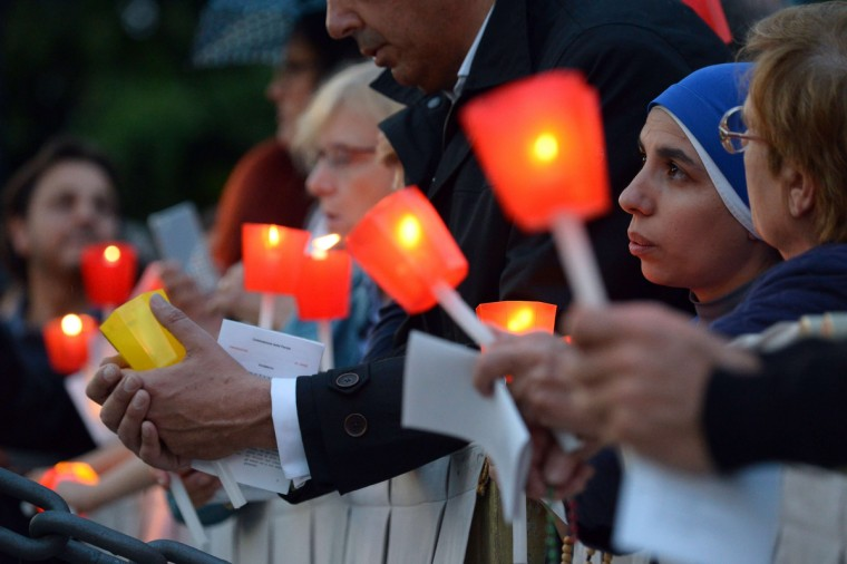 Nuns attend the celebration of a rosary event marking the closing of the Marian month at the Lourdes Grotto in the Vatican's Gardens. (Vincenzo Pinto/AFP/Getty Images)