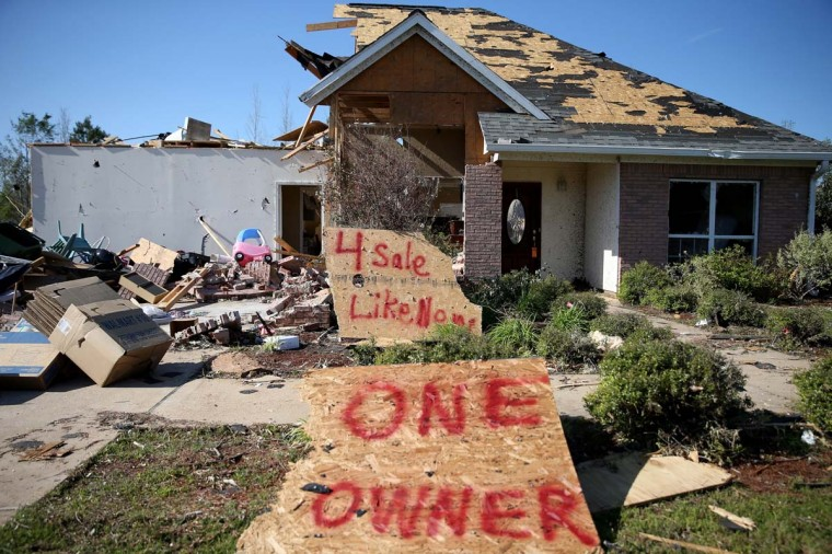 "A sign reads, "" 4 sale Like New One Owner"", in front of a home that was damaged by the tornado that on Monday tore through town on May 1, 2014 in Louisville, Mississippi. A string of deadly tornadoes tore through the region beginning on April 27, leaving more than two dozen dead.   (Photo by Joe Raedle/Getty Images)"