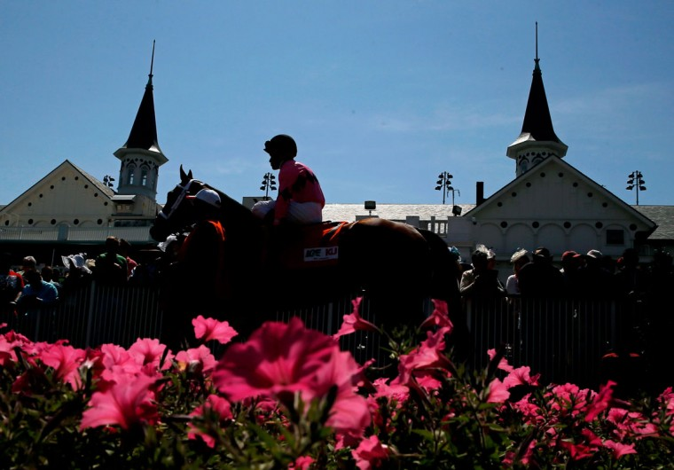 A horse and jockey walk past the twin spires prior to the 140th running of the Kentucky Derby at Churchill Downs on May 3, 2014 in Louisville, Kentucky. (Photo by Kevin C. Cox/Getty Images)