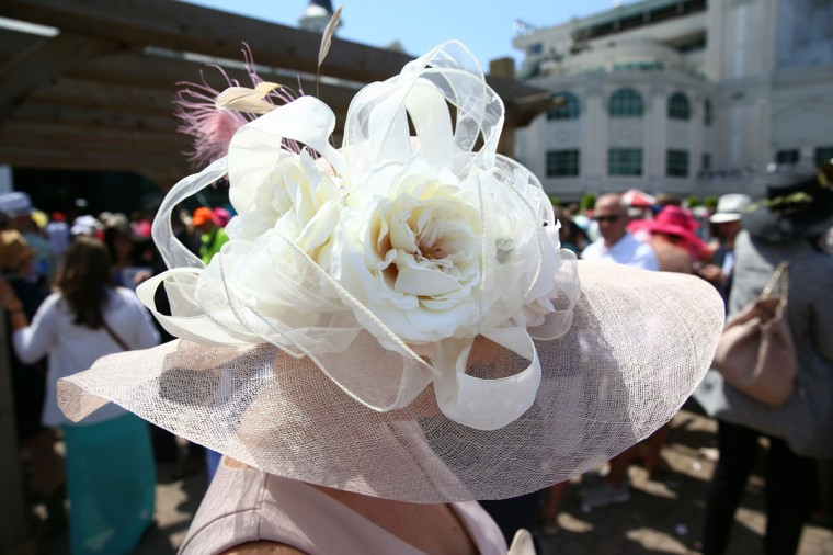A race fan wearing a festive hat attends the 140th running of the Kentucky Derby at Churchill Downs on May 3, 2014 in Louisville, Kentucky. (Photo by Andy Lyons/Getty Images)