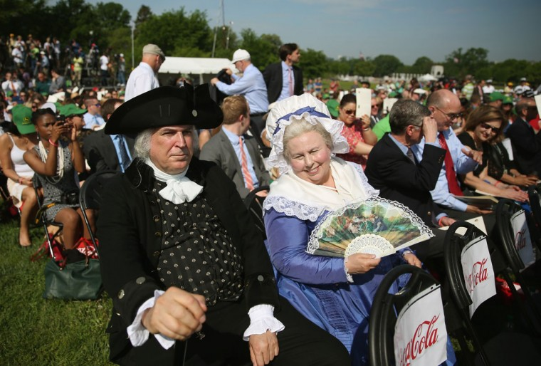 George and Martha Washington impersonators attend the Washington Monument reopening ceremony. (Photo by Mark Wilson/Getty Images)