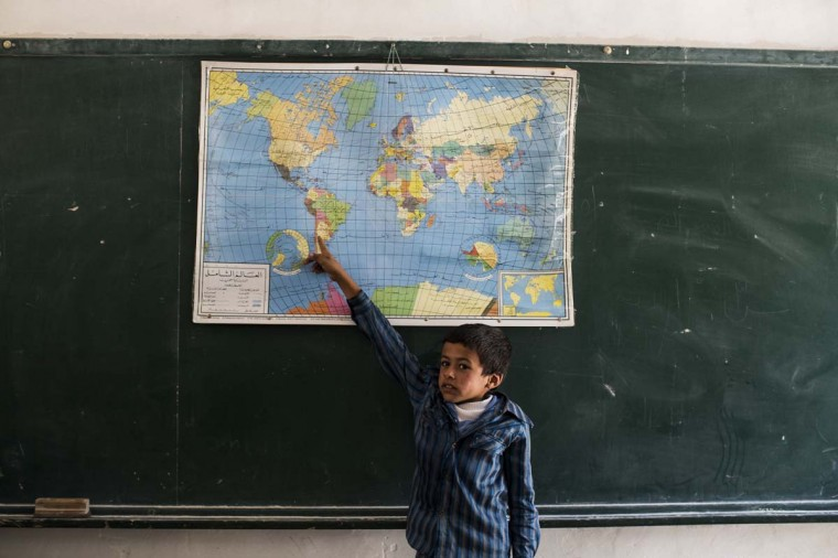 A pupil takes part in a classroom activity at a Palestinian Bedouin of Jahaline tribe school in the area of E1, not far from the settlement of Maale Adumim, on May 13, 2014 in Wadi Abu Hindi, West Bank. The school, the largest for Beduins in the area of E1 teaches, 190 children from tribes around the area. Some of the A pupil are unable to walk to school because of the long distances involved and no road infrastructure, and are forced to use donkeys. (Ilia Yefimovich/Getty Images)