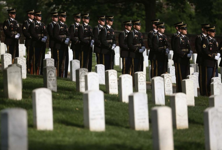 A US Military Honor Guard participates in a wreath laying ceremony at the grave of Army Pvt. William Christman, as part of Arlington at 150 Celebration on May 13, 2014 in Washington, DC. Pvt. Christman was the first military burial at Arlington 150 years ago today on May 13, 1864. (Mark Wilson/Getty Images)