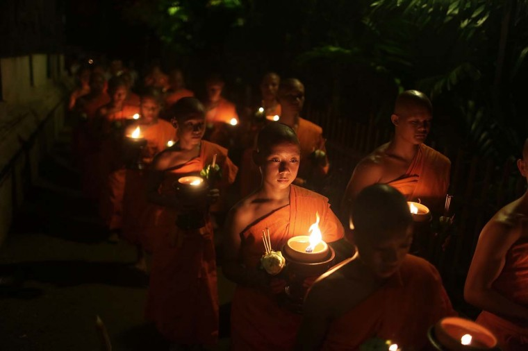 Thai monks at Wat Pan Tao lead a procession three times around the temple in a ceremony celebrating Visak Day on May 13, 2014 in Chiang Mai, Thailand. Visak Day is a Theravada Buddhist religious holiday commemorating the birth, enlightenment, and death of the Buddha. (Taylor Weidman/Getty Images)