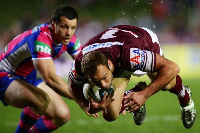 Brett Stewart of the Sea Eagles is tackled by Jarrod Mullen of the Knights during the round 10 NRL match between the Manly-Warringah Sea Eagles and the Newcastle Knights at Brookvale Oval on May 19, 2014 in Sydney, Australia. (PMatt King/Getty Images)
