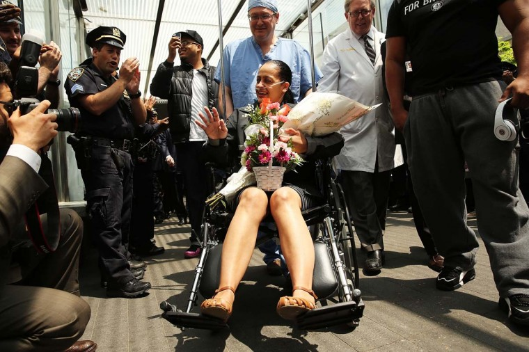 New York City Police Department officer Rosa Rodriguez is cheered by dozens of fellow officers as she is wheeled out of Weill Cornell Medical Center following severe injuries received in a Coney Island fire last month on May 19, 2014 in New York City. Officer Rodriguez, who was critically injured in the fire, lost her partner Officer Dennis Guerra in the incident. Police have said that 16-year-old Marcell Dockery has admitted to lighting a mattress on fire in the hallway of the building because he was bored. Thirty six year-old Rodriguez is a mother of four has been in the hospital since the April. (Spencer Platt/Getty Images)