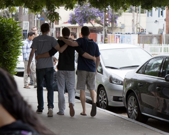 Students and Isla Vista residents walk past a crime scene on May 24, 2014 in Santa Barbara, California. A mentally disturbed 22-year-old man sprayed bullets from his car in the Southern California college town of Isla Vista, killing seven people. (Spencer Weiner/Getty Images)