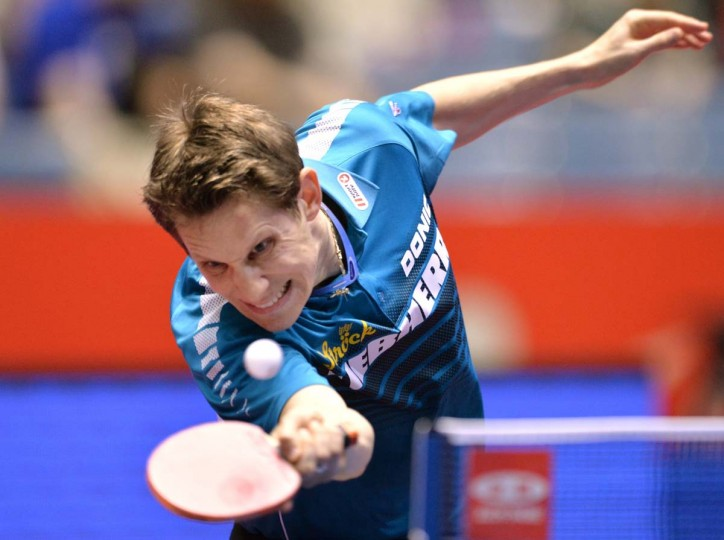 Austria's Robert Gardos returns a shot against Kalinikos Kreanga of Greece during their match in the men's team championship division knockout rounds at the 2014 World Team Table Tennis Championships in Tokyo on May 2, 2014.      || CREDIT: KAZUHIRO NOGI - AFP/GETTY IMAGES