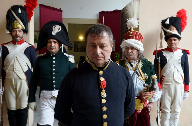 Roberto Colla of Italy dressed as Napoleon Bonaparte poses on May 4, 2014, in the harbor of Portoferraio, on the Italian island of Elba. (VINCENZO PINTO/AFP/Getty Images)