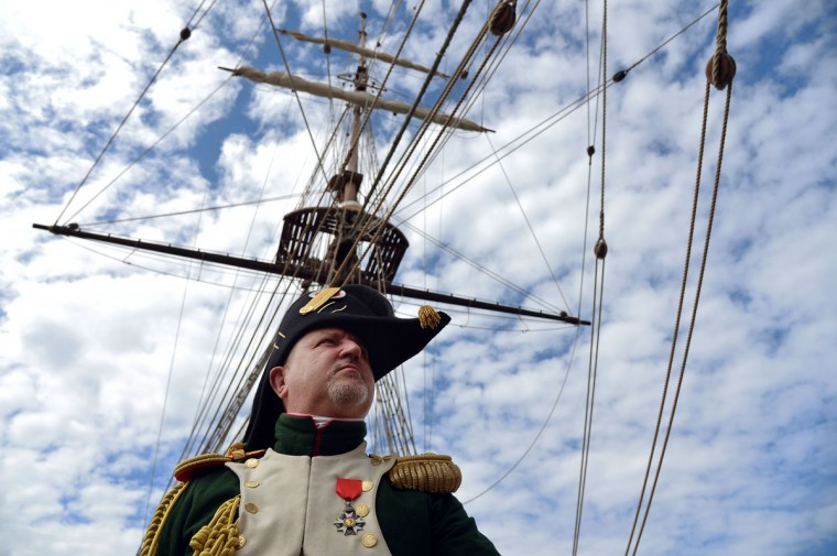 "A man dressed as a Napoleonian soldier takes part in a reconstruction aboard ""The Grace"", an old frigate, on May 4, 2014, in the harbor of Portoferraio on the Italian island of Elba. (VINCENZO PINTO/AFP/Getty Images)"